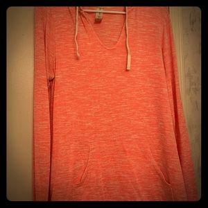 Lightweight orange sweatshirt with front pockets